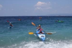 Kayaks landing on a Skopelos beach