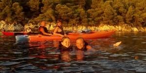 Kids having fun on a sunset kayak trip